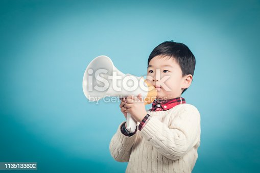 istock Boy with megaphone making an announcement 1135133602