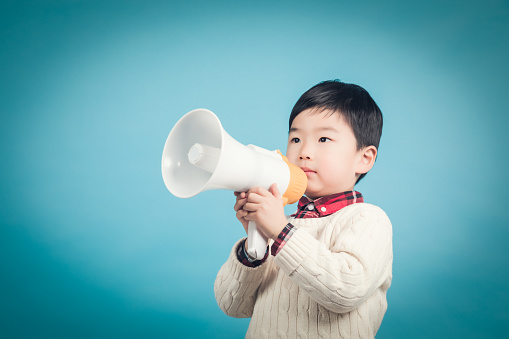 623763462 istock photo Boy with megaphone making an announcement 1135133602