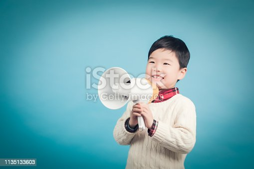 istock Boy with megaphone making an announcement 1135133603