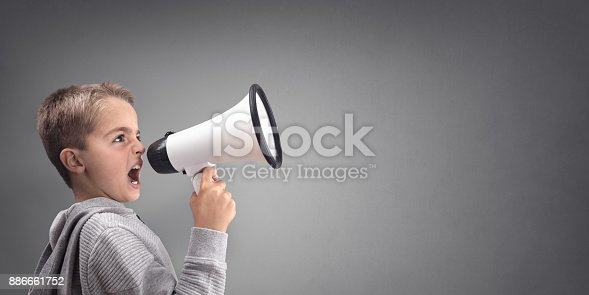istock Boy with megaphone making an announcement 886661752