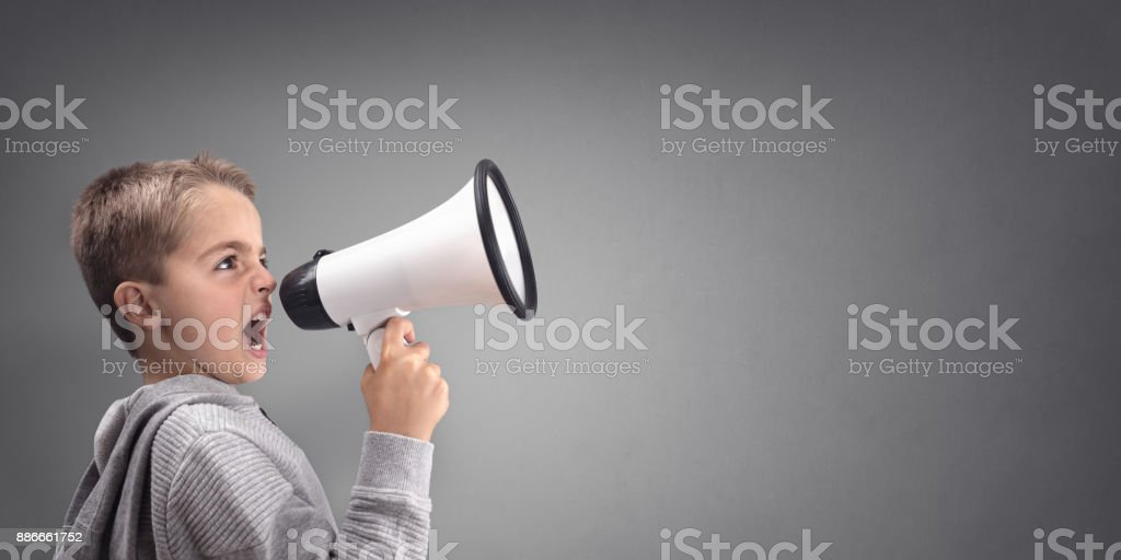 Boy with megaphone making an announcement stock photo