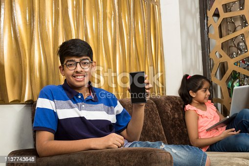 Teenager boy, Indian, Technology, Using,