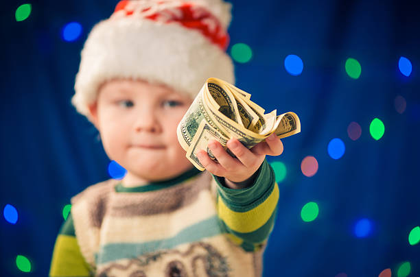boy with money on holiday stock photo