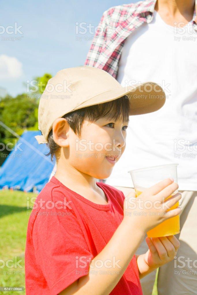 Boy with orange juice royalty-free stock photo