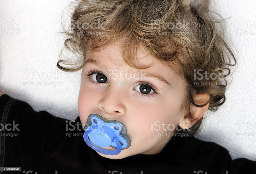 boy with pacifier portrait stock photo