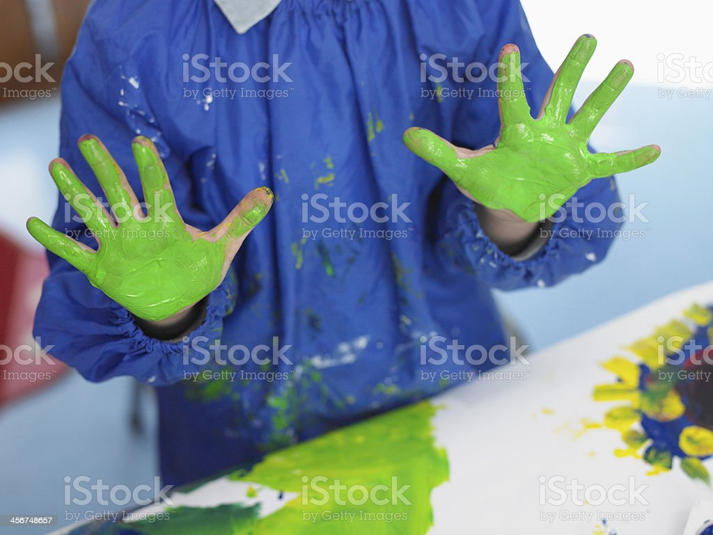 Boy With Painted Hands In Art Class stock photo