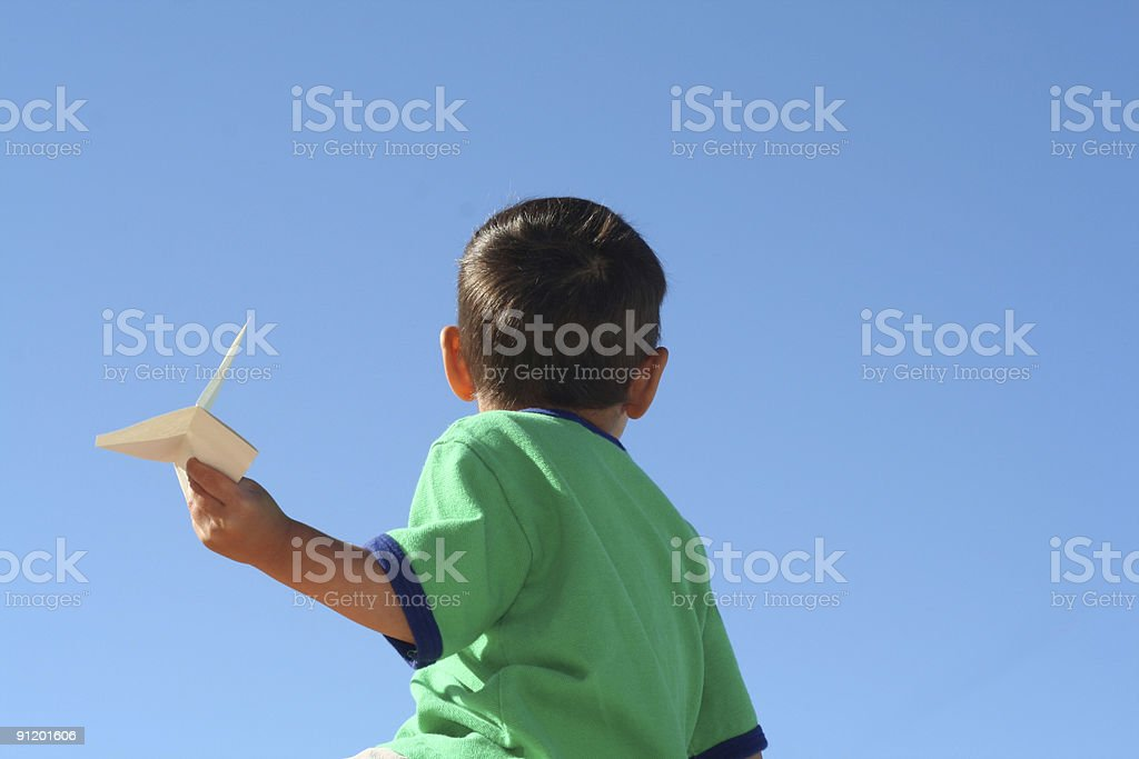 Boy with paper airplane royalty-free stock photo
