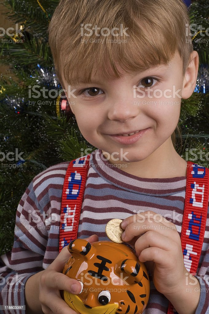 Boy with piggy bank royalty-free stock photo