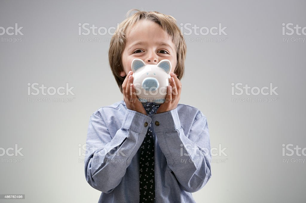 Boy with piggy bank stock photo
