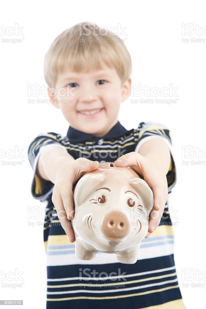 Boy with Piggy Bank royaltyfri bildbanksbilder