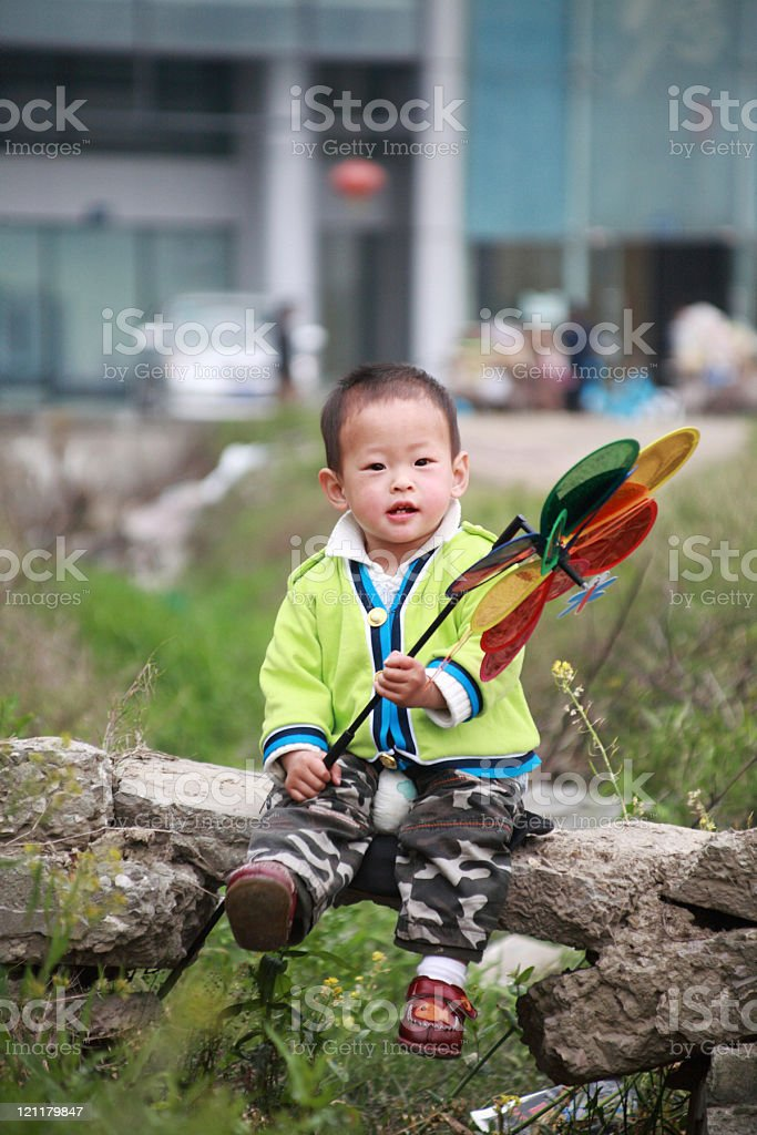 boy with  pinwheel stock photo