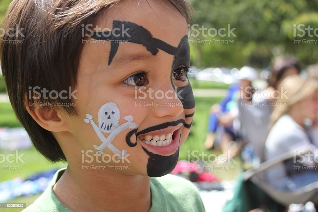 Boy with Pirate Face Paint - Side View stock photo