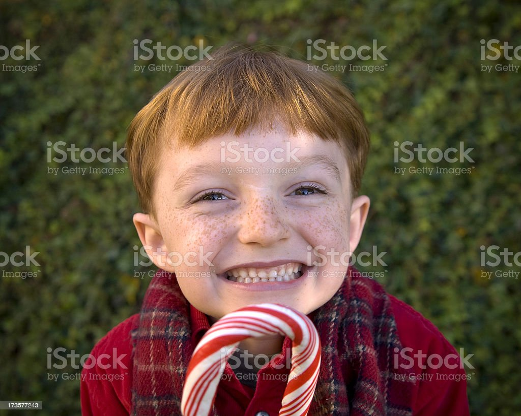 Boy with Red Hair & Freckles & Christmas Candy royalty-free stock photo