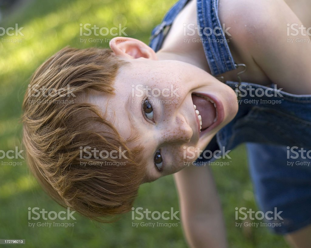 Boy with Red Hair & Freckles Happy & Laughing in Coveralls royalty-free stock photo