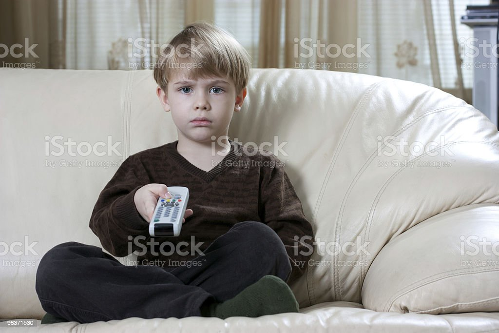 boy with remote control royalty-free stock photo