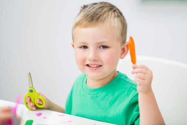 Boy With Scissors stock photo