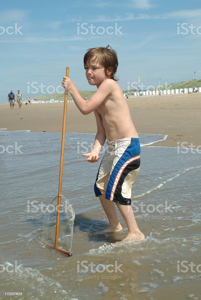Boy with shrimp net royalty-free stock photo