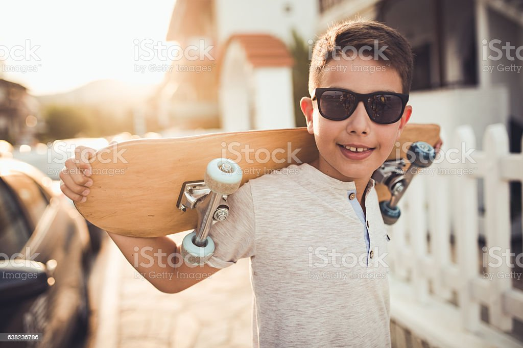 Boy with skateboard stock photo