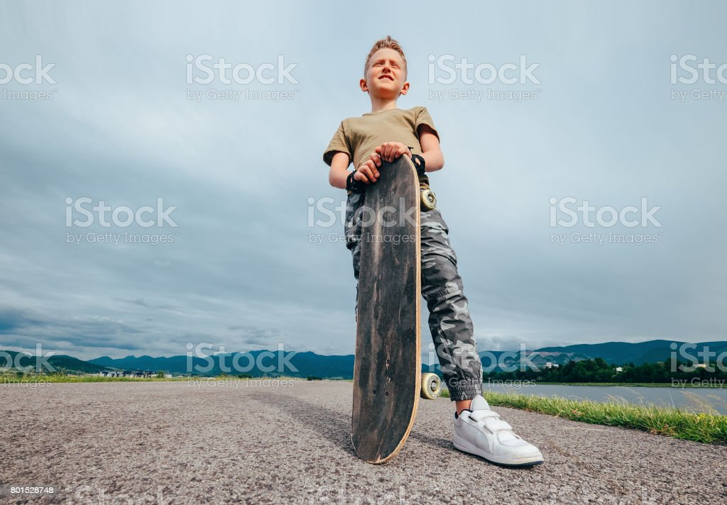 Boy with skateboard stock photo