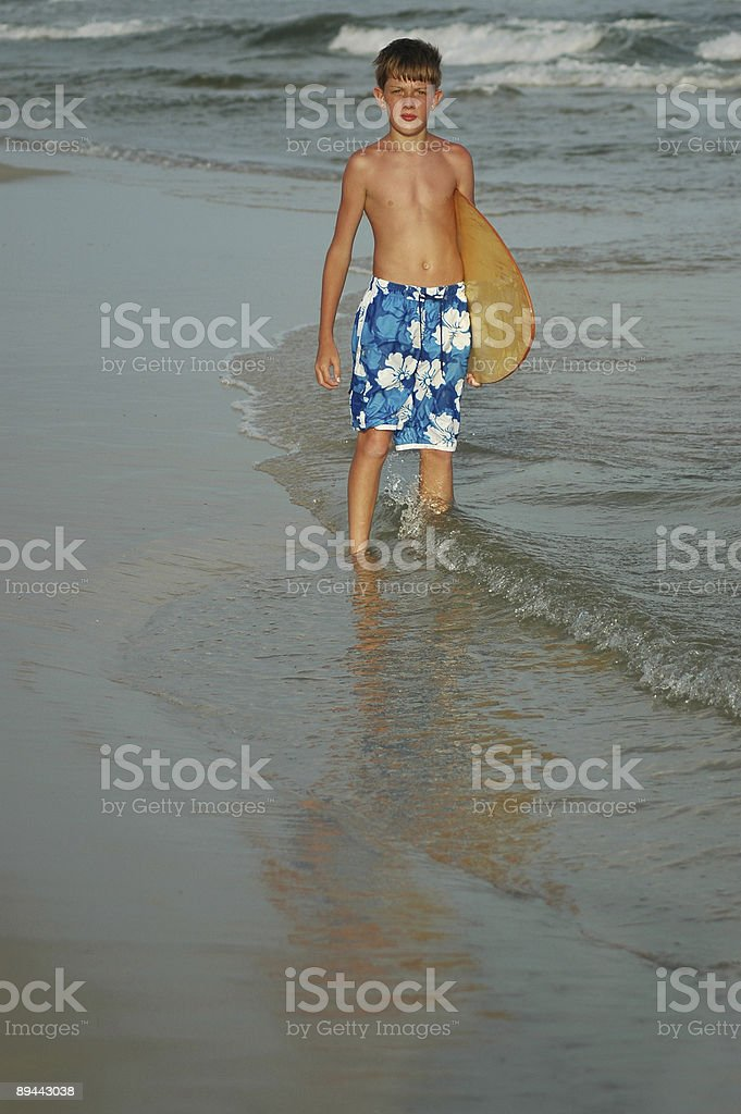 Boy with Skimboard at Beach royalty-free stock photo