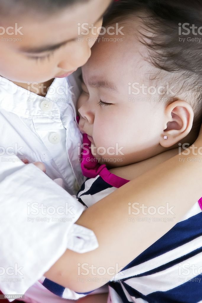 Boy with sleeping baby sister. royalty-free stock photo