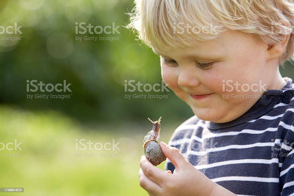 Boy with Snail stock photo