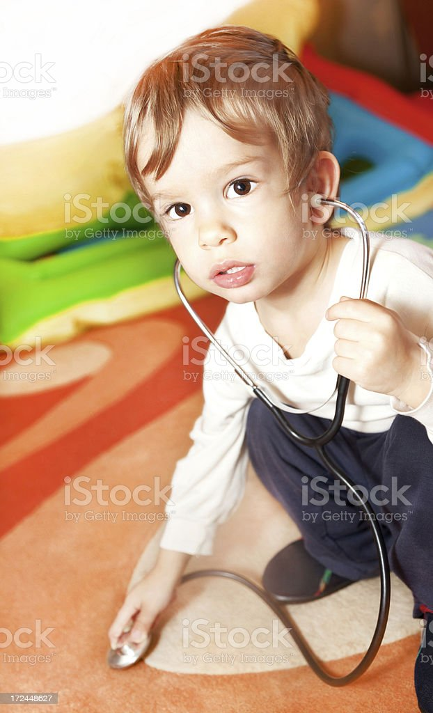 Boy with stethoscope royalty-free stock photo