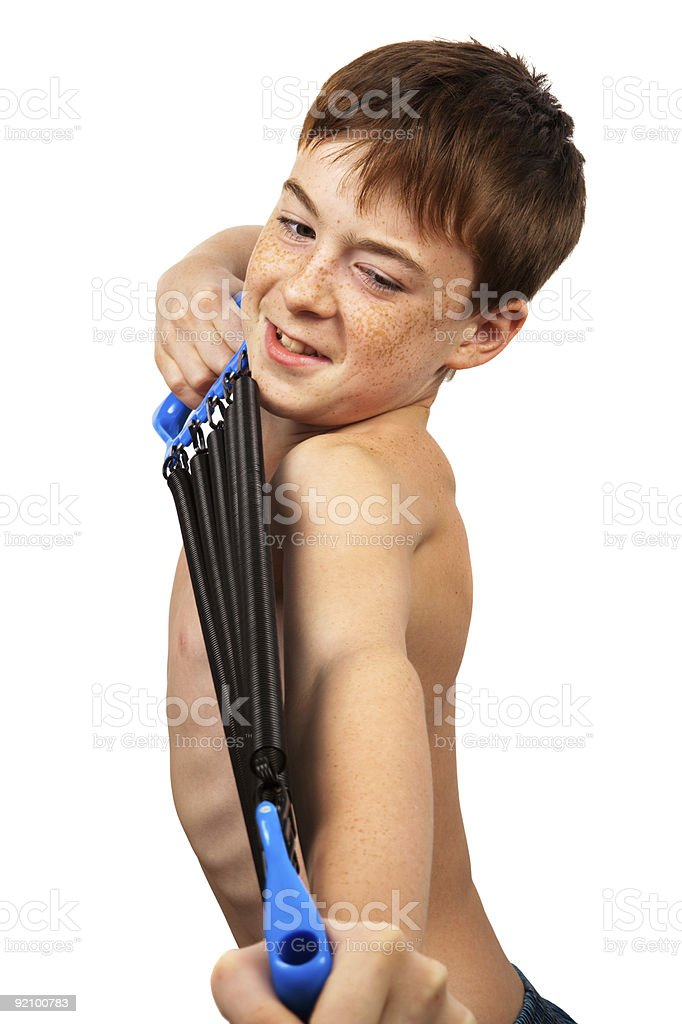 boy with the expander royalty-free stock photo