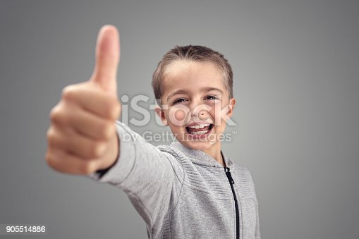 istock Boy with thumbs up agreeing 905514886