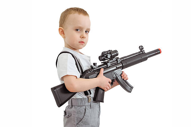 Best Toy Gun Stock Photos, Pictures & Royalty-Free Images