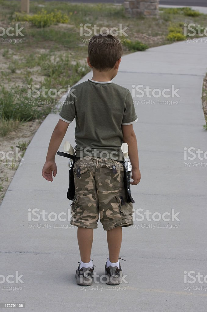 Boy with toy guns. royalty-free stock photo