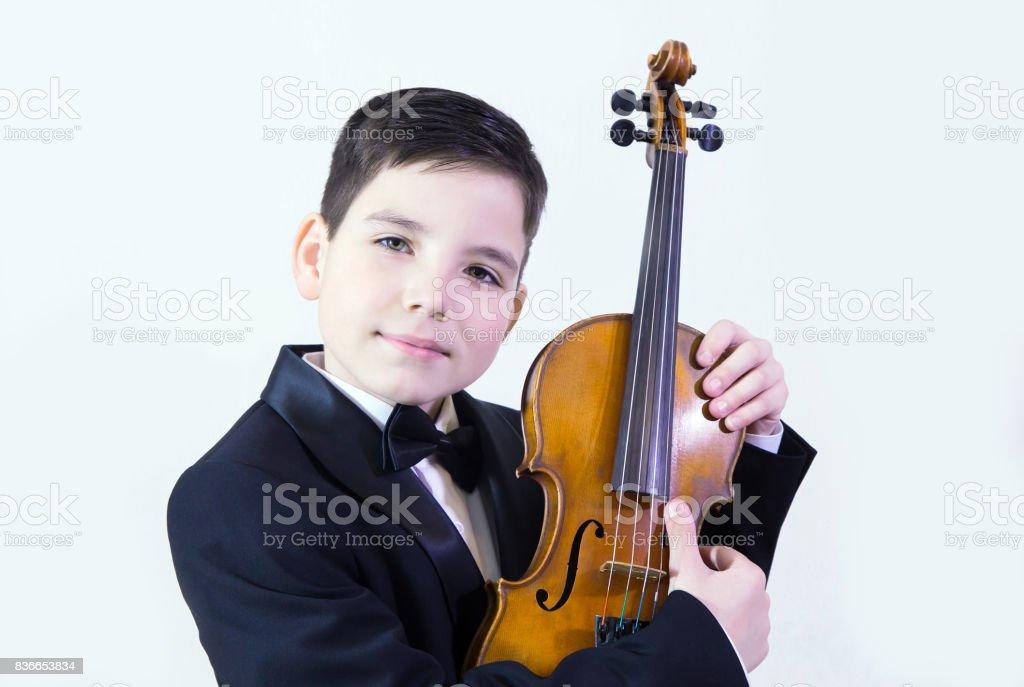 Boy with violin stock photo