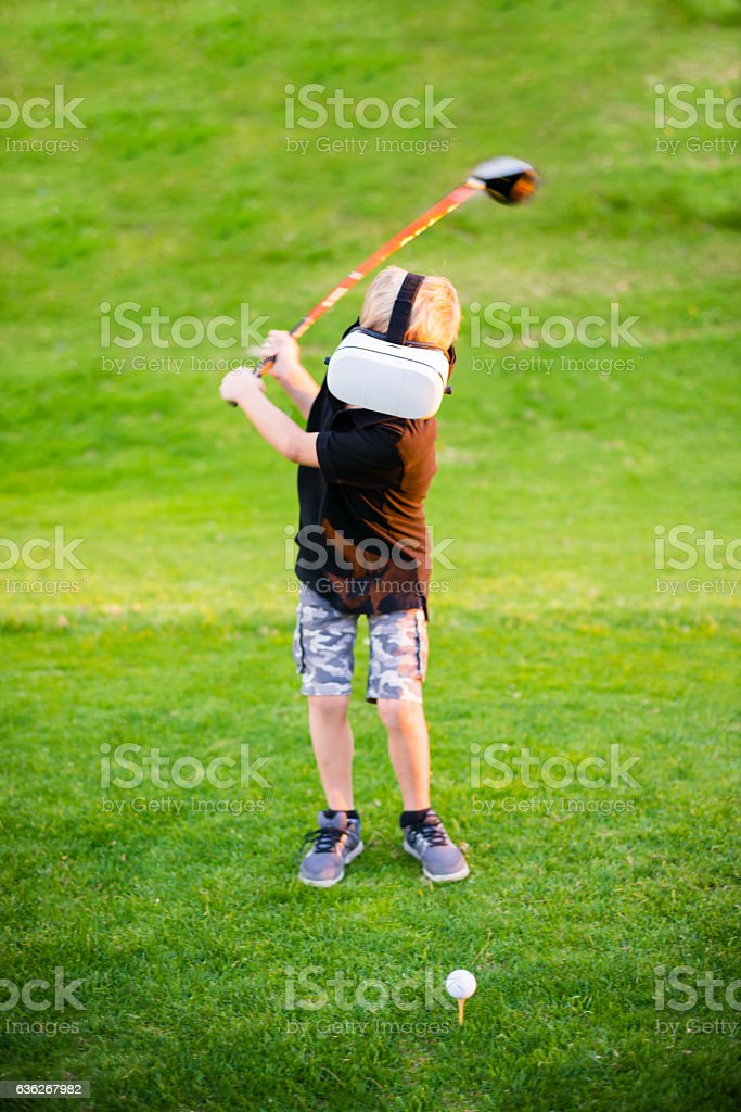 Boy With Virtual Reality Glasses On The Golf Course