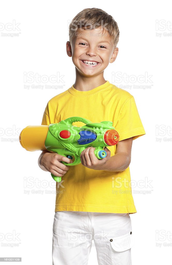 Boy with water gun stock photo