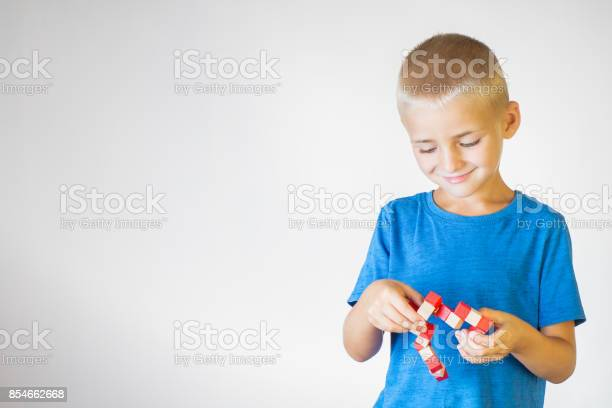 Boy with wooden logical toy child playing educational toys picture id854662668?b=1&k=6&m=854662668&s=612x612&h=hm  wzh8xs6 ruz6eesgvrbv7bjbqg4o2sroj37kizs=