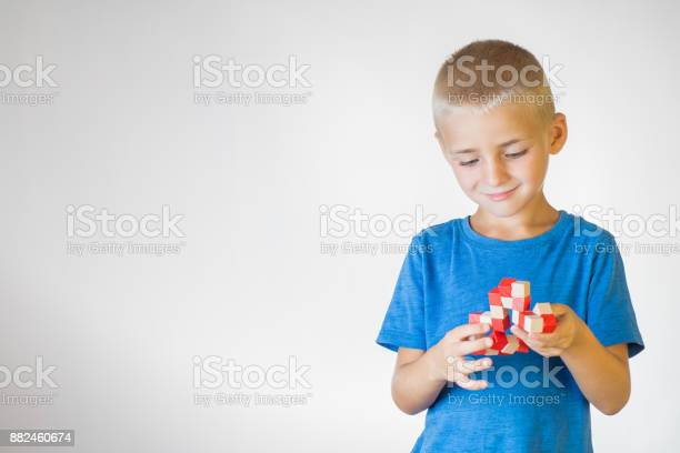 Boy with wooden logical toy child playing educational toys picture id882460674?b=1&k=6&m=882460674&s=612x612&h=qqbmrpmepwnbyhrjoonjvorkeyfz5bclfpc7rmgy6 0=