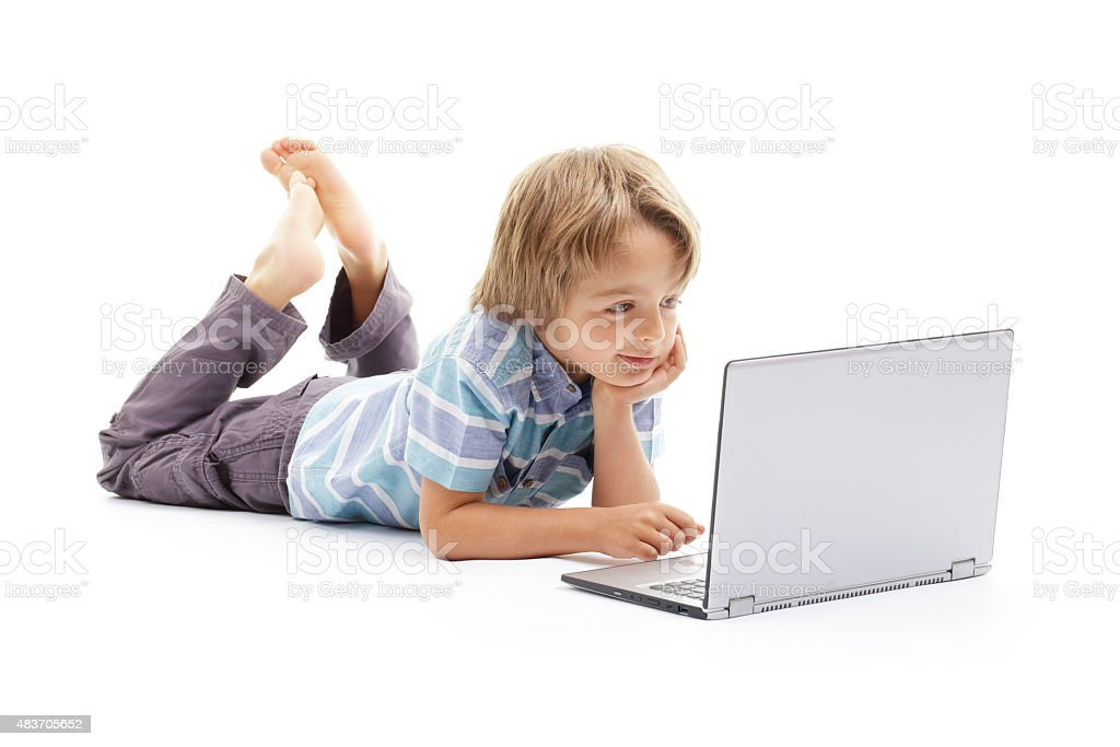 Boy working on laptop computer stock photo