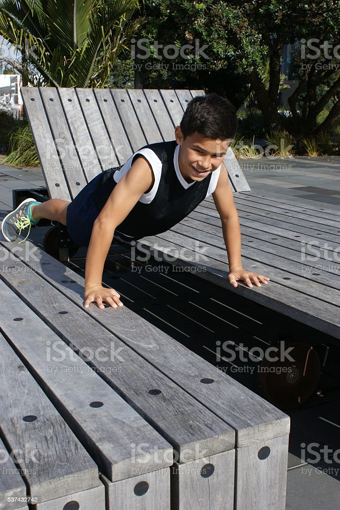 Boy working out in an urban park stock photo