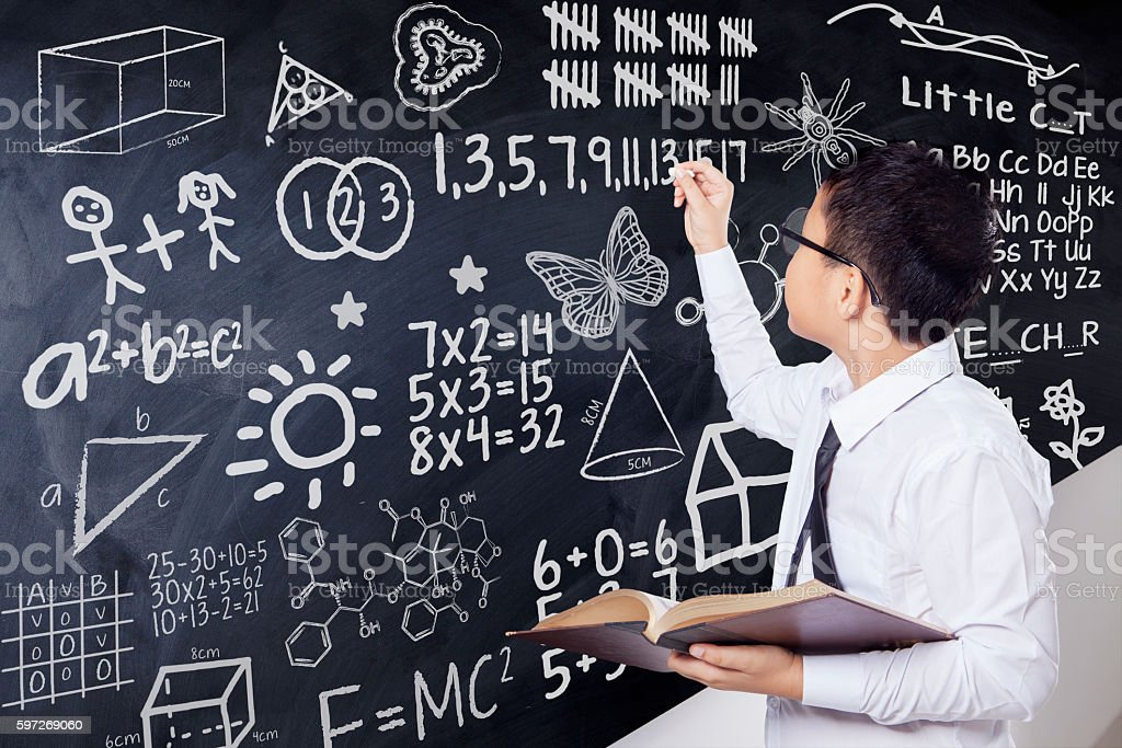 Boy writes mathematics formula in class royalty-free stock photo