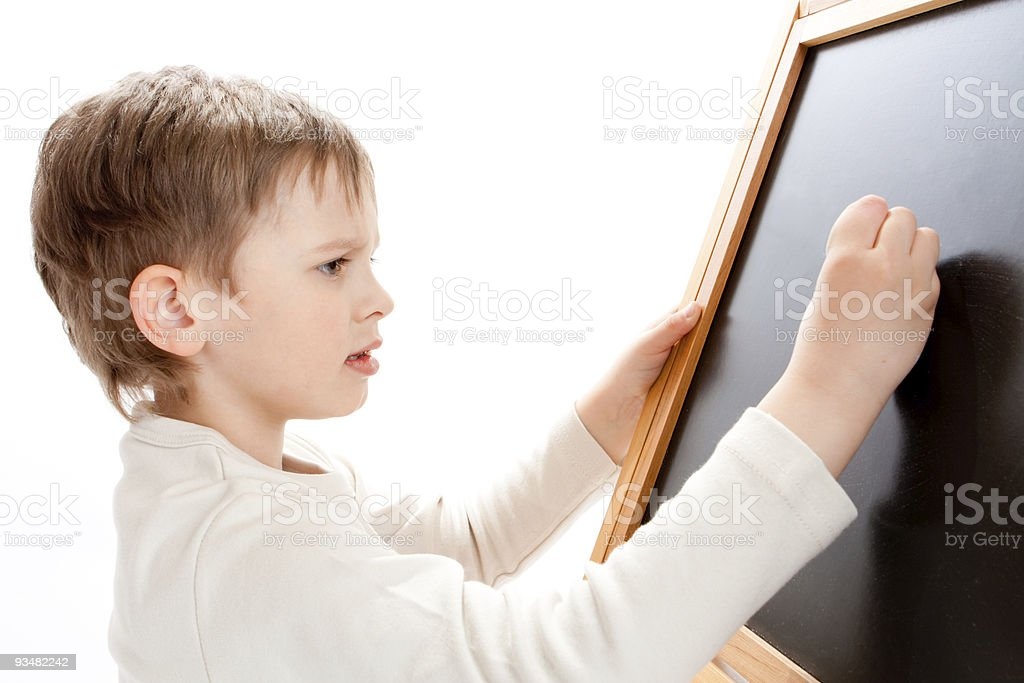 Boy writing on blackboard royalty-free stock photo