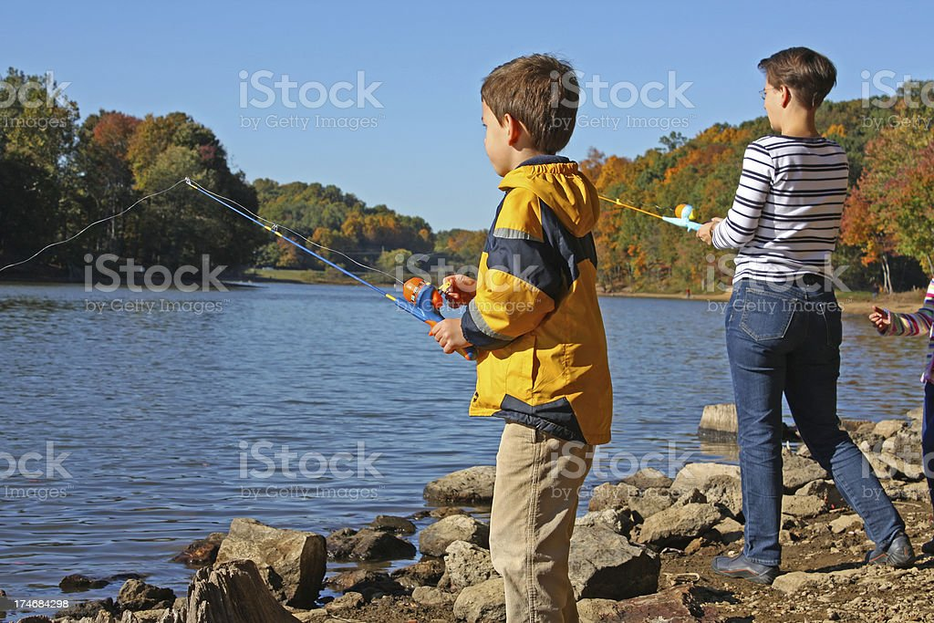 Boy/child and mother fishing at a lake royalty-free stock photo