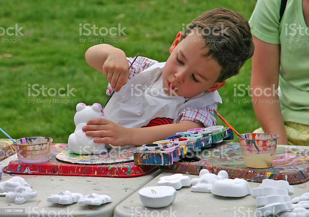 Boy/child doing outdoor painting / hand crafting royalty-free stock photo