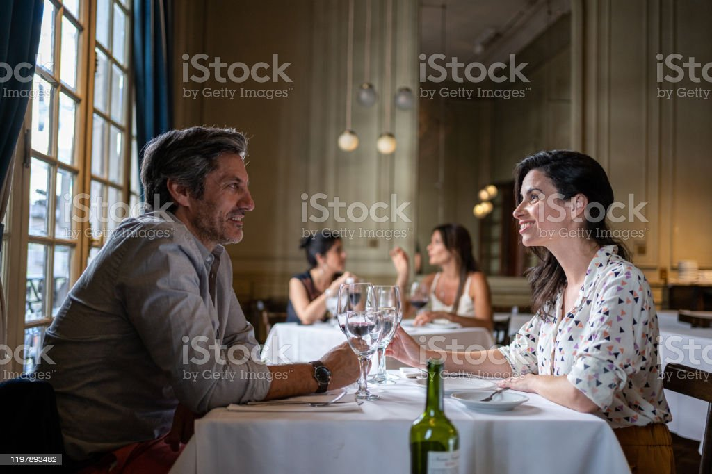 Boyfriend And Girlfriend On A Date In A Luxury Restaurant Stock Photo Download Image Now Istock