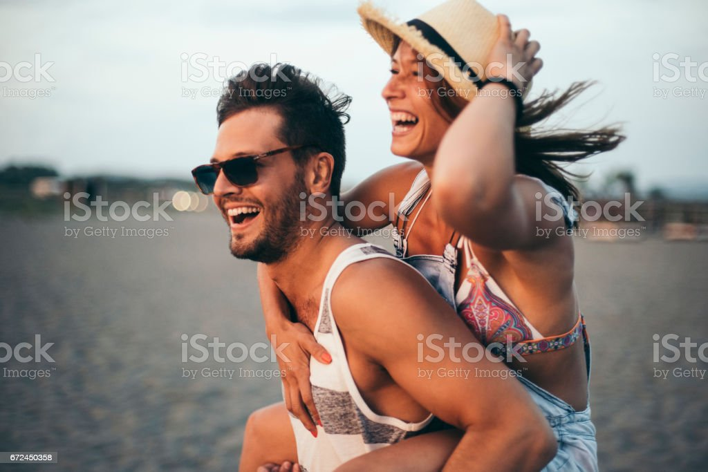 Boyfriend carrying his girlfriend stock photo