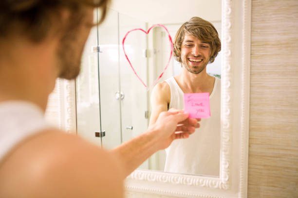 boyfriend discovering a love message on the mirror - i love you stock photos and pictures
