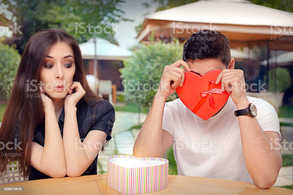Boyfriend Embarrassed with his Valentine Gift stock photo