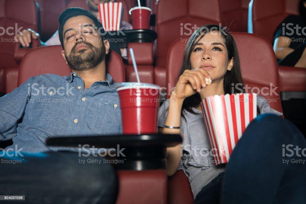 Boyfriend falling asleep at the movies stock photo