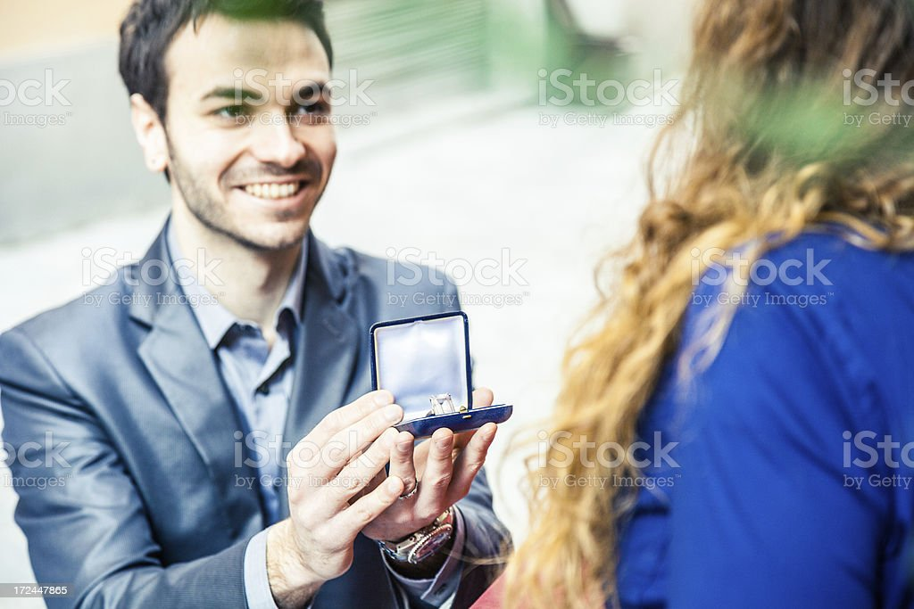 Boyfriend gives a gift to his girlfriend royalty-free stock photo