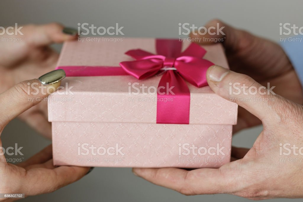 boyfriend gives his girlfriend a gift box stock photo more
