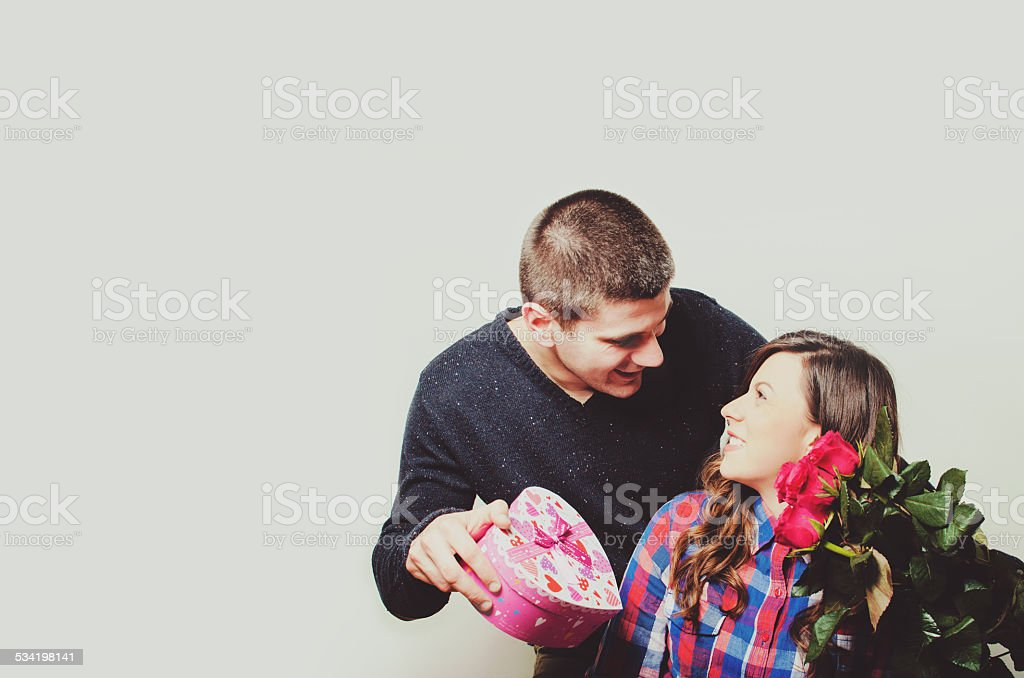 Boyfriend giving his girlfriend a Valentine's present. stock photo